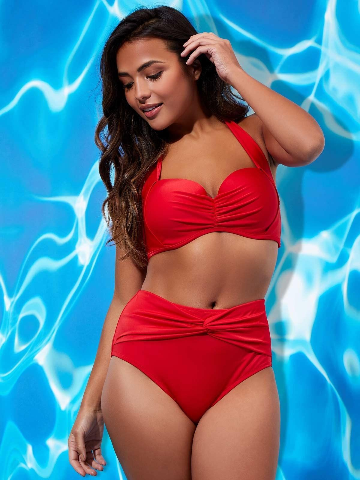 A high-waisted bikini is a must this summer season; this flattering style in red is bound to turn heads on the beach.
