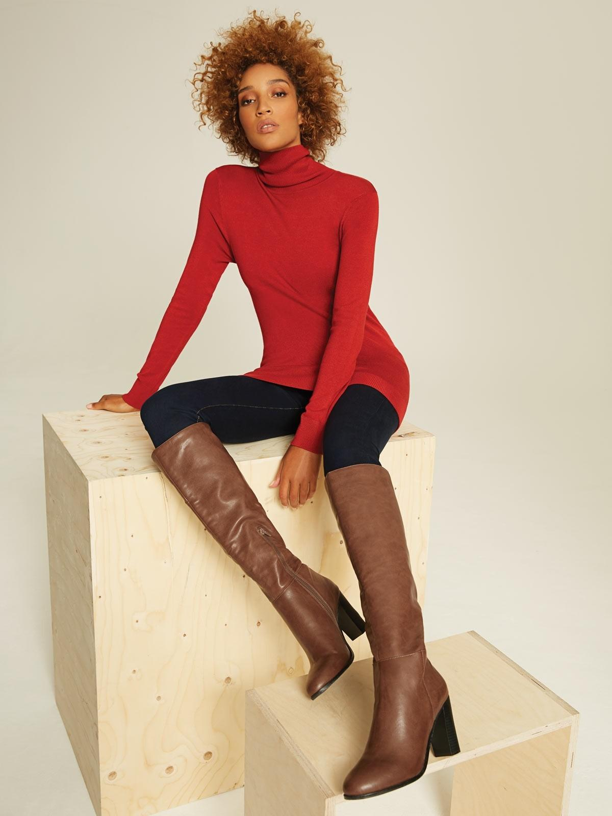 These knee-high boots give sophisticated edge to any party outfit.