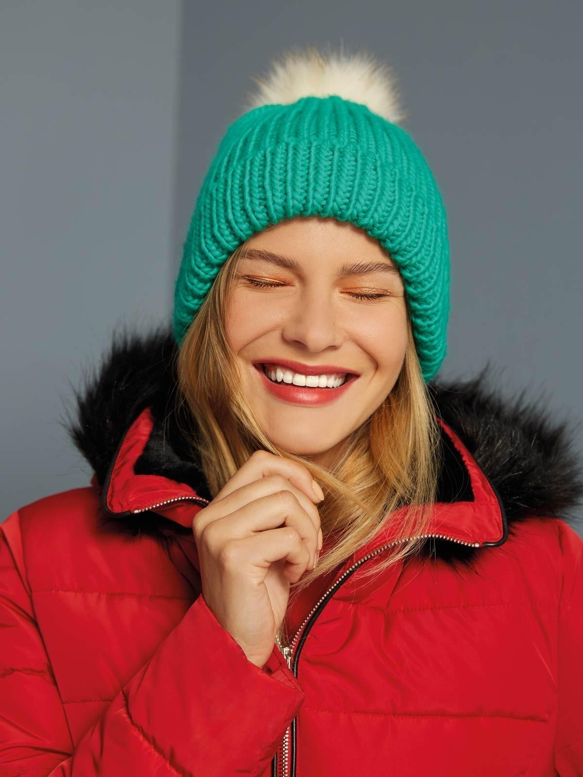 This cosy green pom hat makes the perfect Christmas gift or stocking filler for a mum-to-be.