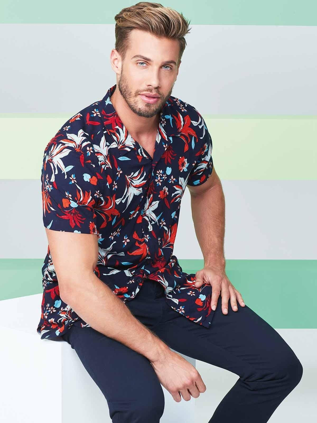 This navy shirt with red floral accents is a steal- a tropical print will definitely get you into the holiday spirit!
